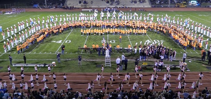 The Pennsbury Marching Band performed with middle school band members during the Be Our Guest event at Falcon Field.