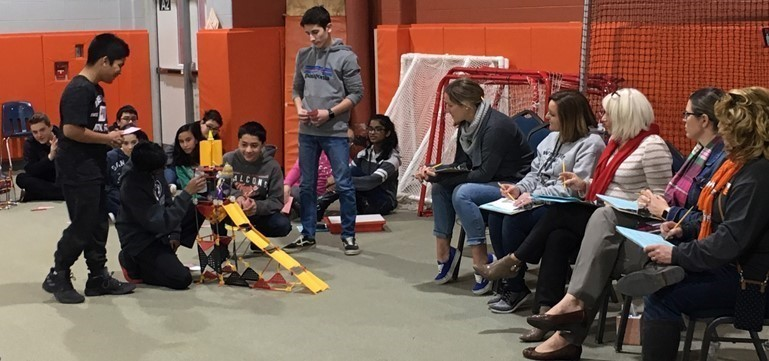 Judges listened intently as William Penn Middle School eighth graders demonstrated their enviro-friendly amusement rides during the K'nex STEM Design Challenge.