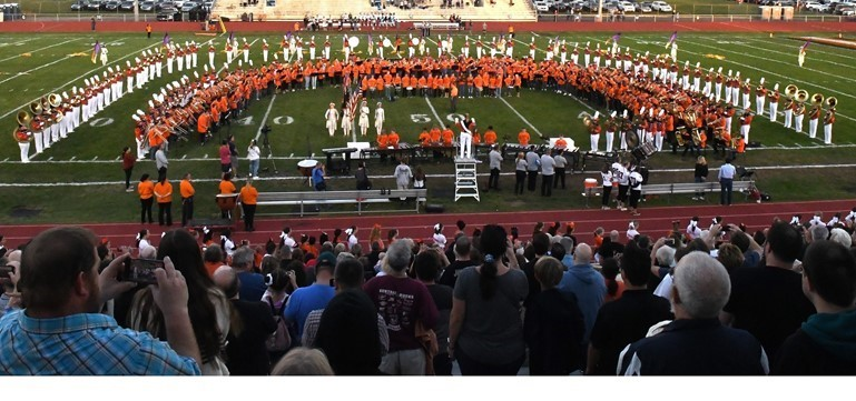 "A total of 500 students performed the Star Spangled Banner at Falcon Field when the Pennsbury Marching Band invited instrumental students from all three Pennsbury middle schools to join them for the annual ""Be Our Guest"" event."